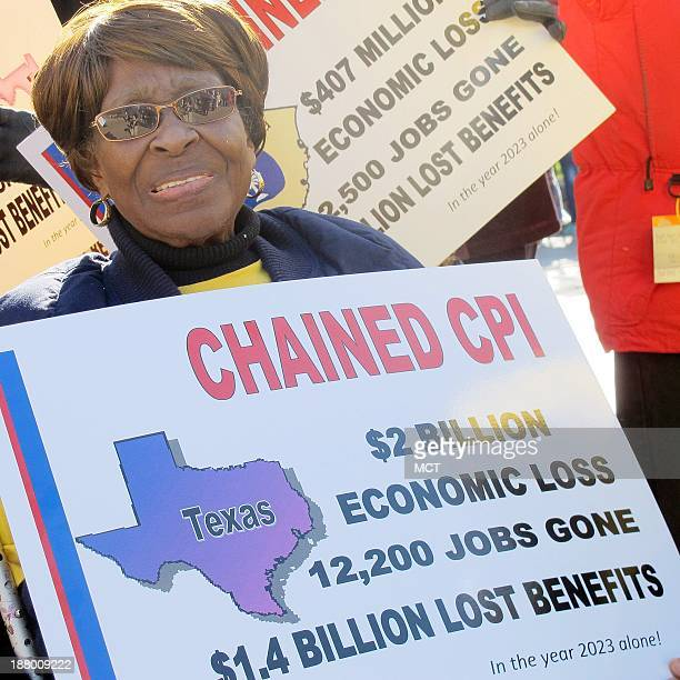 Alberta Gaskins holds a sign in front of the White House in Washington, Thursday, Nov. 14 protesting possible changes to how Social Security...