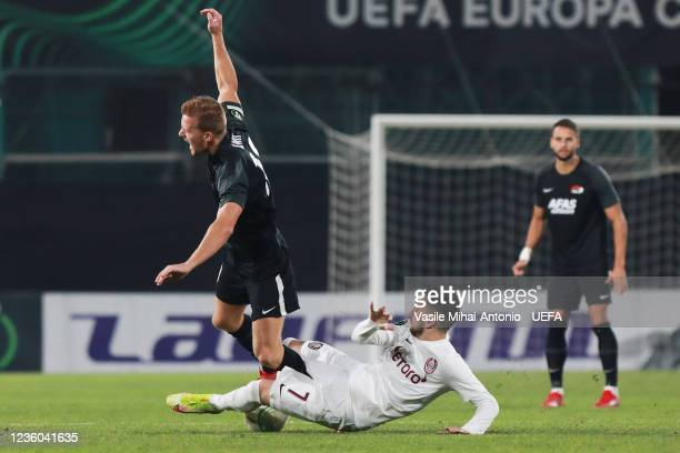 Alberta Gudmundsson of AZ Alkmaar is challenged by Constantin Paun of CFR Cluj during the UEFA Europa Conference League group D match between CFR...