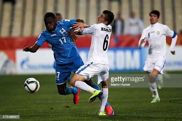 Alberth Elis of Honduras battles with Akramjon Komilov of Uzbekistan during the Group E Group E FIFA U20 World Cup New Zealand 2015 match between...
