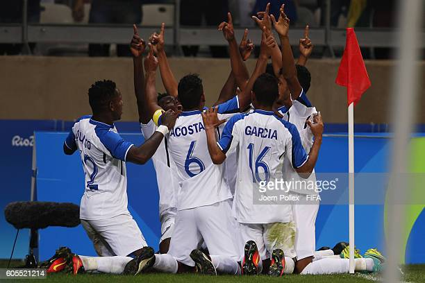 Alberth Elis of Honduras celebrates with his team mates after scoring his team's first goal during the Men's Quarter Final match between Republic of...