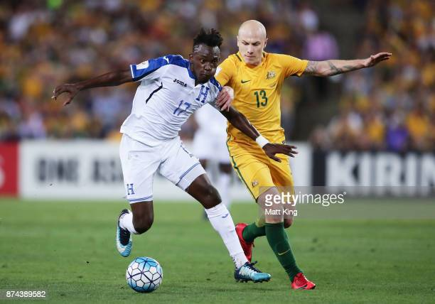 Alberth Elis of Honduras is challenged by Aaron Mooy of Australia during the 2018 FIFA World Cup Qualifiers Leg 2 match between the Australian...