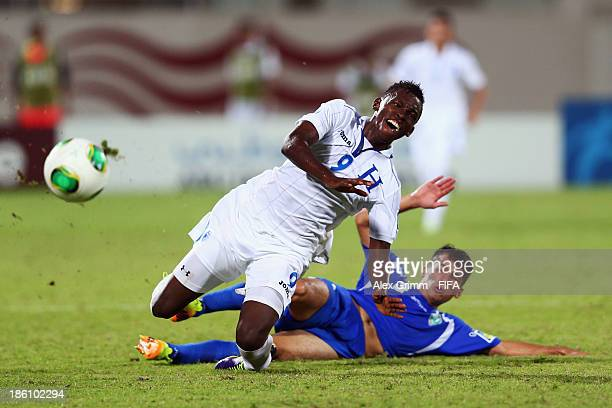 Alberth Elis of Honduras is challenged by Abdulaziz Ashurmatov of Uzbekistan during the FIFA U17 World Cup UAE 2013 Round of 16 match between...