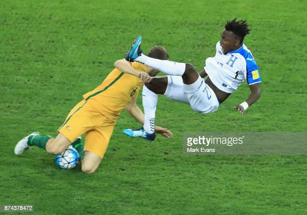 Alberth Elis of Honduras is fouled by Matthew Jurman of Australia during the 2018 FIFA World Cup Qualifiers Leg 2 match between the Australian...