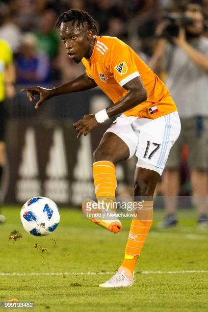 Alberth Elis of Houston Dynamo attempts a pass against the Colorado Rapids at Dick's Sporting Goods Park on July 14, 2018 in Commerce City, Colorado.
