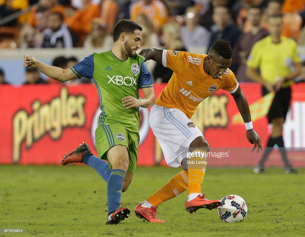 Alberth Elis #17 of Houston Dynamo fends off Cristian Roldan #7 of Seattle Sounders as he brings the ball up the field in the second half at BBVA Compass Stadium on November 21, 2017 in Houston, Texas.