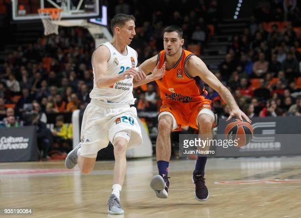 Alberto Abalde #6 of Valencia Basket competes with Jaycee Carroll #20 of Real Madrid during the 2017/2018 Turkish Airlines EuroLeague Regular Season...