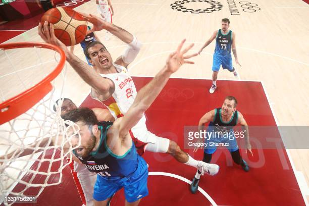 Alberto Abalde of Team Spain drives to the basket against Mike Tobey and Zoran Dragic of Team Slovenia during the second half of a Men's Basketball...