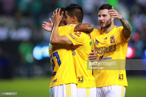 Alberto Acosta Hugo Ayala and Andre Pierre Gignac of Tigres celebrate winning the championship after the final second leg match between Leon and...