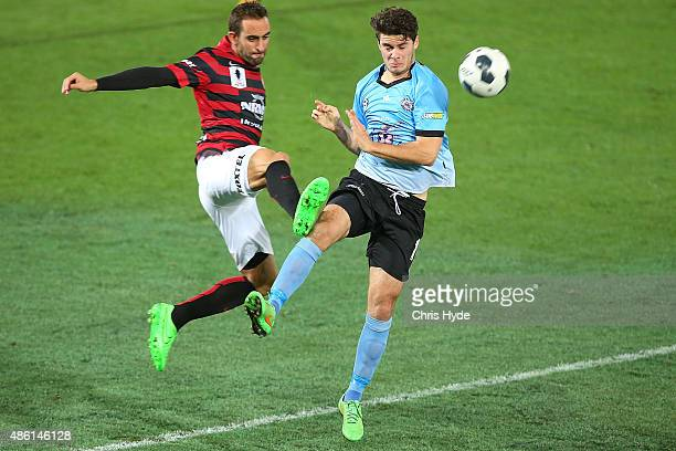 Alberto Aguilar of the Wanderers and Roman Hofmann of the Sharks compete for the ball during the FFA Cup Round of 16 match between Palm Beach Sharks...
