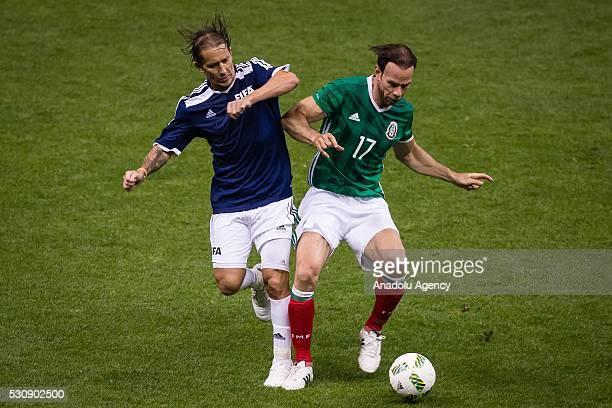 Alberto Alves of Mexican allstar team in action against Michel Salgado of FIFA Football Legends team during a friendly match between Mexican allstar...