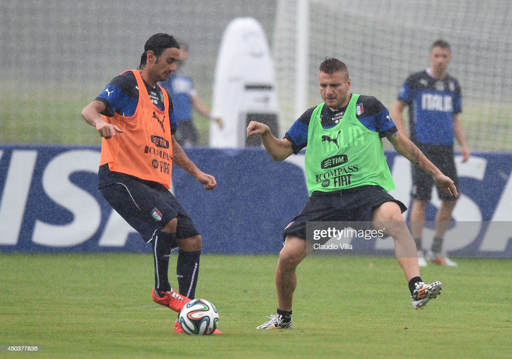 Alberto Aquilani and Ciro Immobile (R) of Italy compete for the ball during a training session on June 10, 2014 in Rio de Janeiro, Brazil.