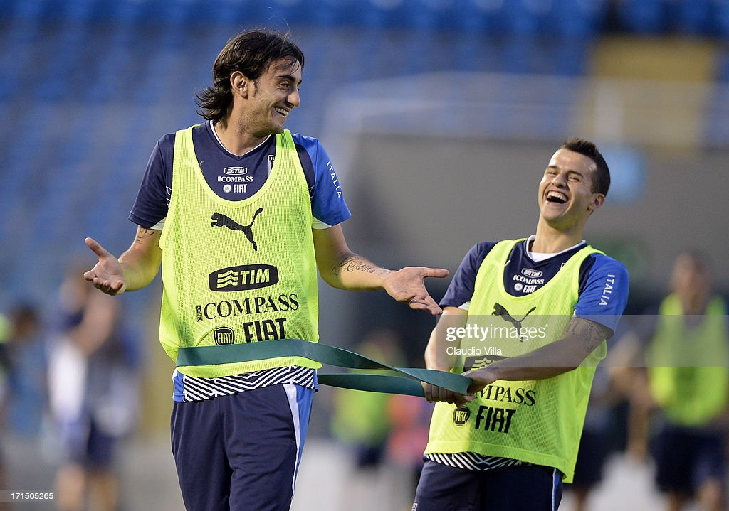 Alberto Aquilani and Sebastian Giovinco (R) joke during an Italy training session at Estadio Presidente Vargas on June 25, 2013 in Fortaleza, Brazil.