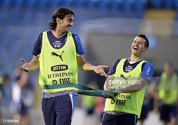 Alberto Aquilani and Sebastian Giovinco joke during an Italy training session at Estadio Presidente Vargas on June 25 2013 in Fortaleza Brazil