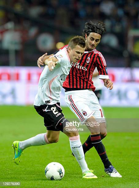 Alberto Aquilani of AC Milan and Josip Ilicic compete for the ball during the Serie A match between AC Milan and US Citta di Palermo at Stadio...