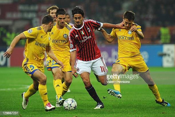 Alberto Aquilani of AC Milan is challenged by Marko Simic and Artyom Radkov of FC BATE Borisov during the UEFA Champions League group H match between...