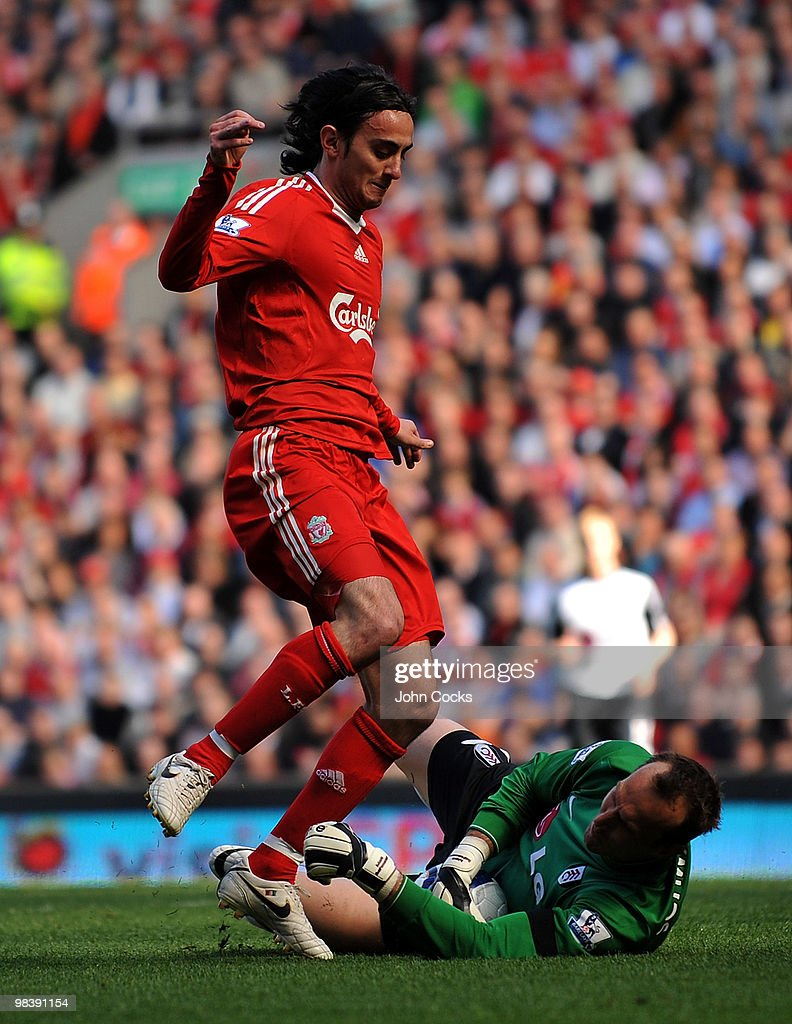 Alberto Aquilani of Liverpool competes with Mark Schwarzer of Fulham during the Barclays Pemier League match between Liverpool Fulham at Anfield on April 11, 2010 in Liverpool, England.