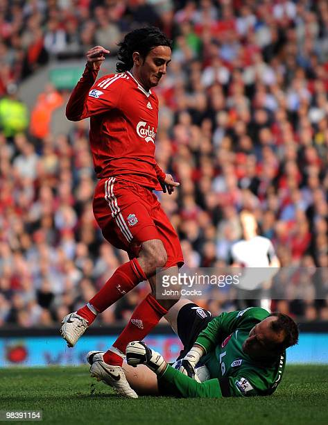 Alberto Aquilani of Liverpool competes with Mark Schwarzer of Fulham during the Barclays Pemier League match between Liverpool Fulham at Anfield on...