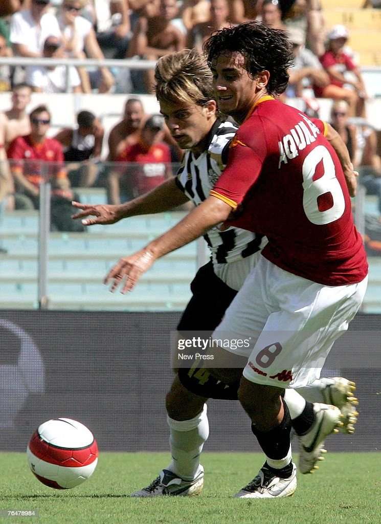 Alberto Aquilani of Roma fights for the ball with Daniele Galloppa of Siena during a Serie A match between Roma and Siena at the Stadio Olimpico on September 02, 2007 in Rome, Italy.