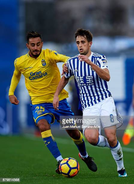 Alberto Aquilani of UD Las Palmas duels for the ball with Adnan Januzaj of Real Sociedad during the La Liga match between Real Sociedad de Futbol and...