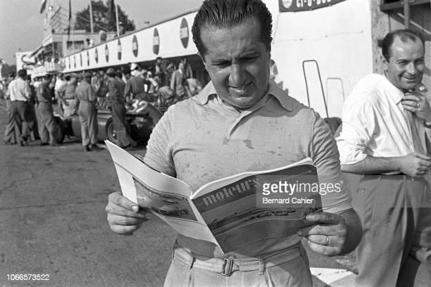 "Alberto Ascari, Grand Prix of Italy, Autodromo Nazionale Monza, 05 September 1954. Alberto Ascari reading a copy of the French magazine ""Moteurs""..."