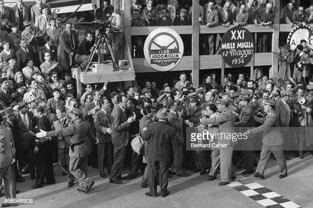 Alberto Ascari, Mille Miglia, Italy, 05 February 1954. Alberto Ascari surrounded by a crowd of journalists and tifosi after his win in the 1954 Mille...
