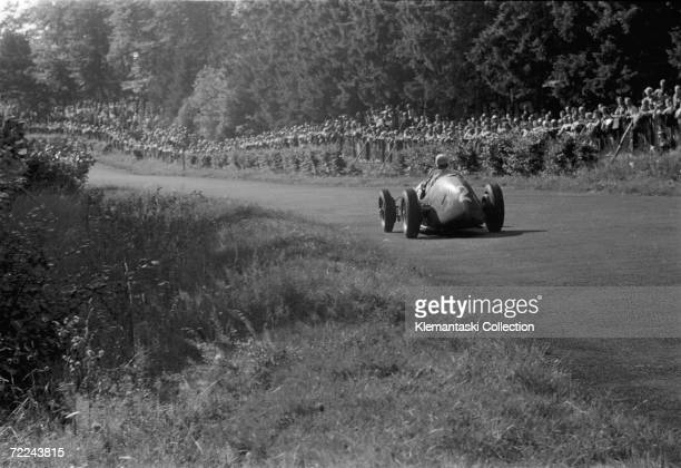 Alberto Ascari on the Hatzenbach section below the North Curve at the Nurburgring, Germany, during the Formula 2 Grand Prix, 20th August 1950.