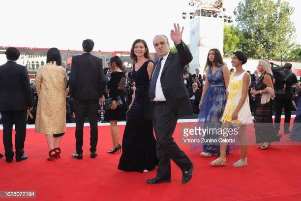 Alberto Bonisoli and a guest walk the red carpet ahead of the opening ceremony and the 'First Man' screening during the 75th Venice Film Festival at...
