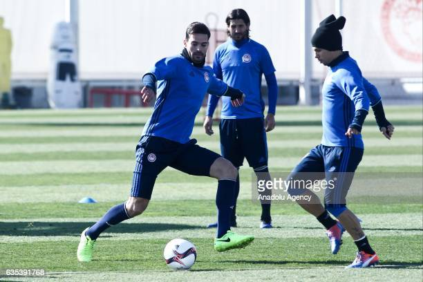 Alberto Botia and Andre Martens of Olympiacos FC attend a training session prior to the UEFA Europa League soccer match between Olympiacos FC and...
