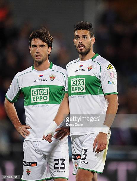 Alberto Botia and Domingo Cisma of Elche FC look on during the La Liga match between Getafe CF and Elche FC at Coliseum Alfonso Perez stadium on...