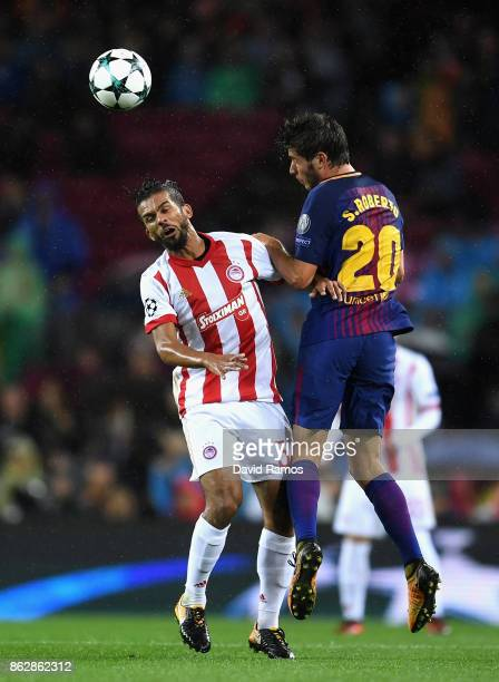 Alberto Botia of Olympiacos and Sergi Roberto of Barcelona battle for possession in the air during the UEFA Champions League group D match between FC...