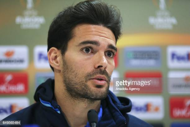 Alberto Botia of Olympiacos attends a press conference prior to the UEFA Europa League round of 16 match between Olympiacos and Besiktas at Georgios...