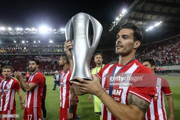 Alberto Botia of Olympiacos holds the trophy during their championship celebration of Superleague Greece at Georgios Karaiskakis Stadium in Piraeus...