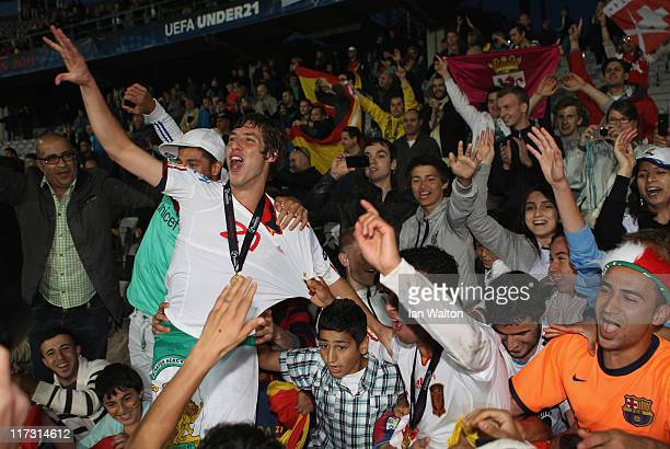 Alberto Botia of Spain celebrates with the fans after their 20 victory in the UEFA European U21 Championship Final match between Switzerland and...