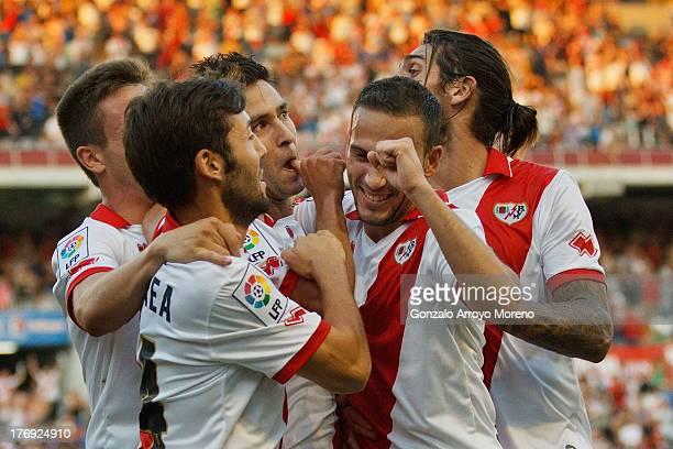Alberto Bueno of Rayo Vallecano de Madrid celebrates scoring their opening goal with teammates during the La Liga match between Rayo Vallecano de...