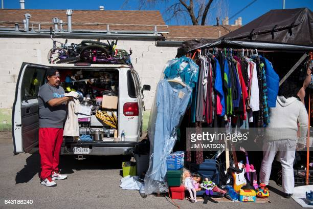Alberto Caballero cleans a cooking pot out of the back his van as his mother Maria Garcia tends their road side shop in El Paso, Texas, next to the...