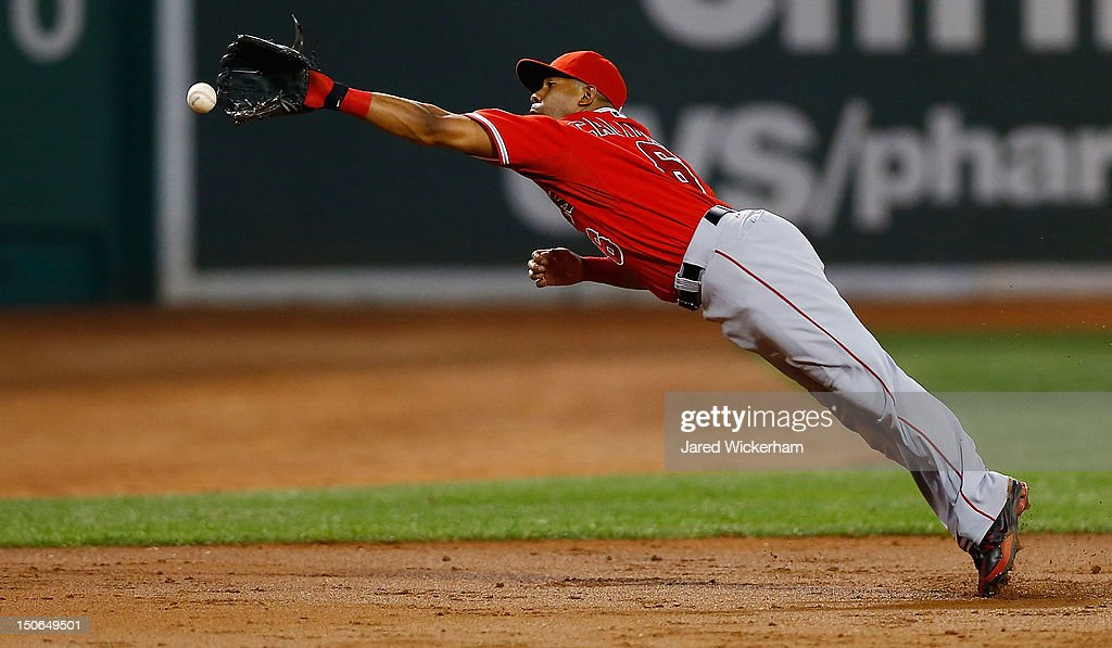 Alberto Callaspo #6 of the Los Angeles Angels dives but cannot come up with the hit down the third base line against the Boston Red Sox during the game on August 23, 2012 at Fenway Park in Boston, Massachusetts.
