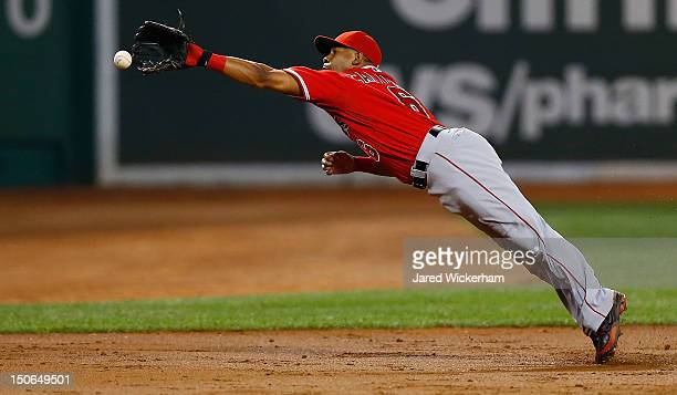 Alberto Callaspo of the Los Angeles Angels dives but cannot come up with the hit down the third base line against the Boston Red Sox during the game...