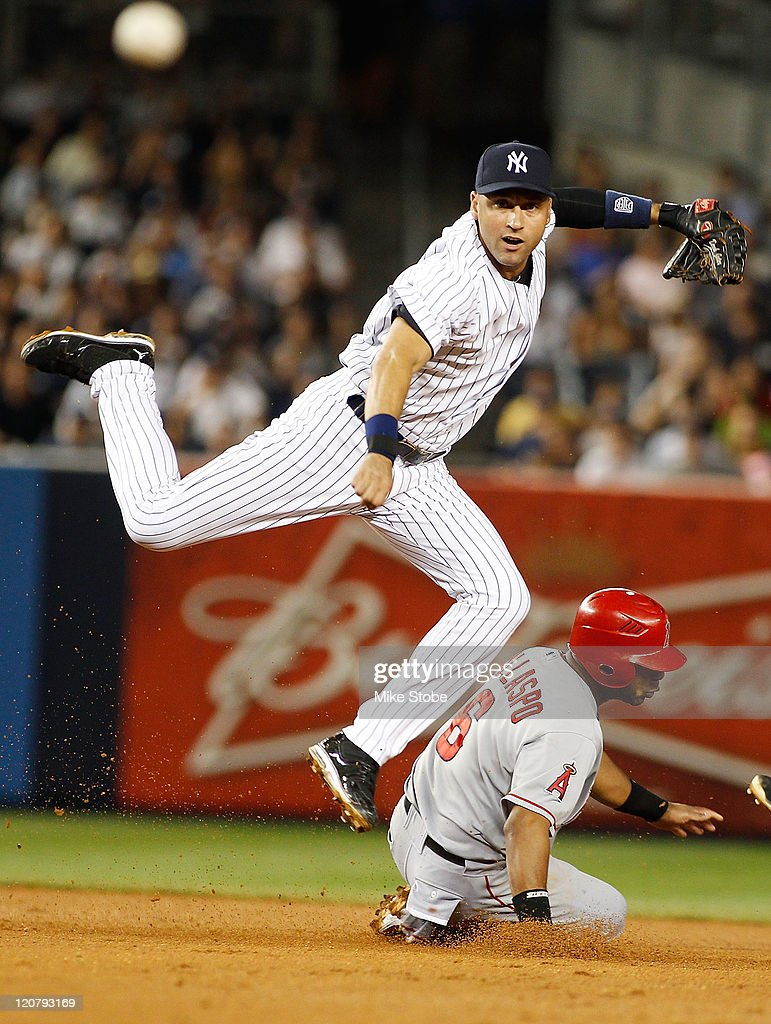 Alberto Callaspo #6 of the Los Angeles Angels of Anaheim is forced out at second as Derek Jeter #2 of the New York Yankees leaps out of the way and completes the double play on August 10, 2011 at Yankee Stadium in the Bronx borough of New York City.