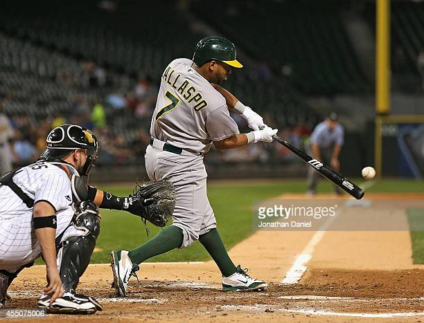 Alberto Callaspo of the Oakland Athletics hits a gourndrule double in the 4th inning against the Chicago White Sox at US Cellular Field on September...