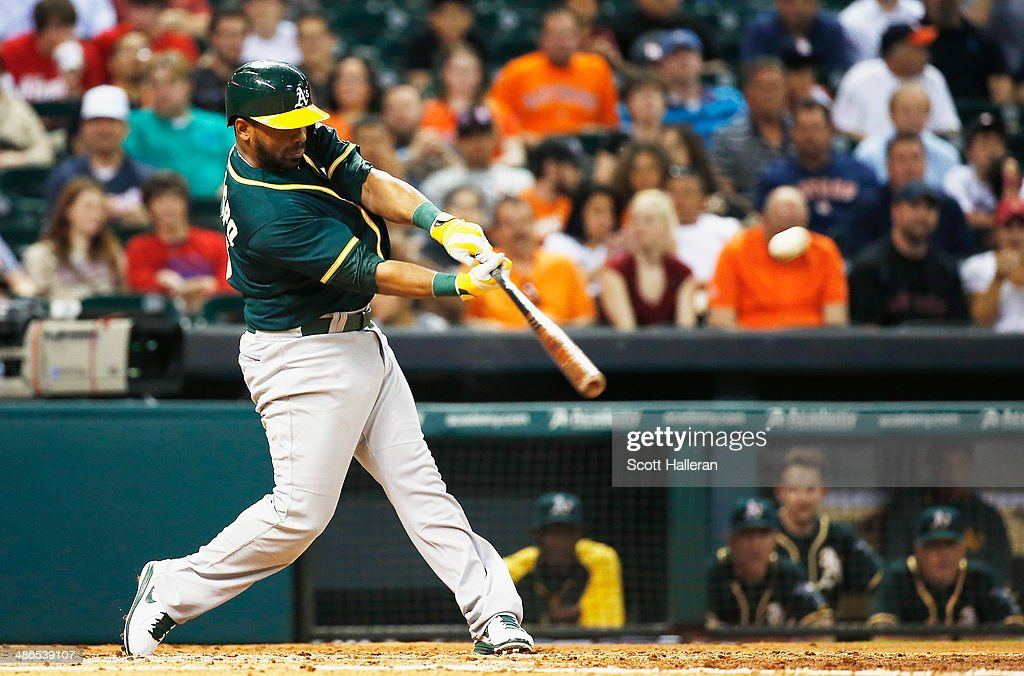 Alberto Callaspo #18 of the Oakland Athletics hits a two-run home run in the third inning of their game against the Houston Astros at Minute Maid Park on April 24, 2014 in Houston, Texas.