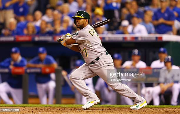 Alberto Callaspo of the Oakland Athletics hits an RBI single scoring Josh Reddick in the 12th inning during the American League Wild Card game at...