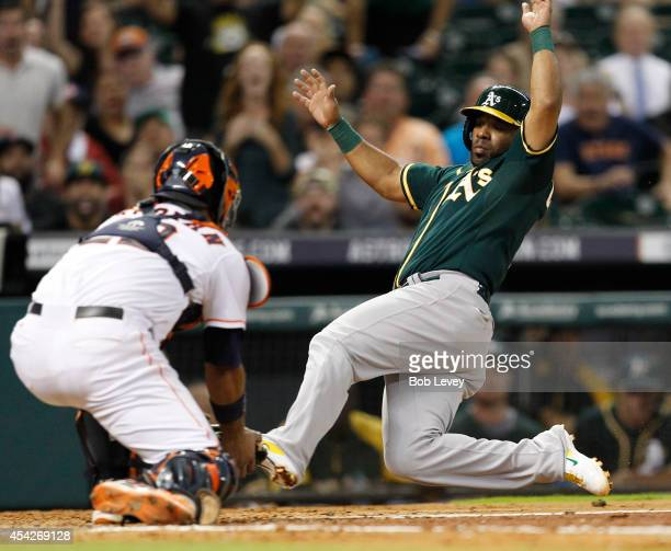 Alberto Callaspo of the Oakland Athletics is tagged out by Carlos Corporan of the Houston Astros trying to score in the fifth inning at Minute Maid...
