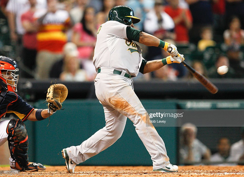 Alberto Callaspo #18 of the Oakland Athletics singles in Brandon Moss #37 of the Oakland Athletics in the ninth inning at Minute Maid Park on April 27, 2014 in Houston, Texas.