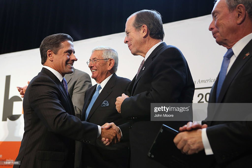 Alberto Carvalho (L), superintendent of Miami-Dade County Public Schools, is congratulated by former Chairman of the Joint Chiefs of Staff Adm. Michael Mullen after Miami-Dade won the 2012 Broad Prize for Urban Education on October 23, 2012 in New York City. The award recognizes a large school district making the greatest progress nationwide in raising overall student achievment while reducing achievement gaps in low-income and minority students. Miami-Dade, a five-time finalist, will receive $550,000 in college scholarships for its high school seniors. The three other finalists, Corona Norco, Houston and Palm Beach, each receive $150,000 in scholarships.