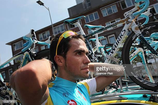 Alberto Contador a two time winner of the Tour de France and with team Astana speaks with teammates while training for the 97th Tour de France...