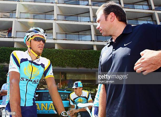 Alberto Contador of Spain and Astana chats to team boss Johan Bruyneel as he prepares to train with his team in preparation for 2009 Tour de France...