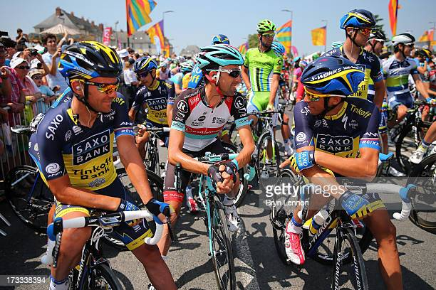 Alberto Contador of Spain and Michael Rogers of Australia and Team Saxo-Tinkoff chat with Haimar Zubeldia of Spain and Team Radioshack Leopard ahead...