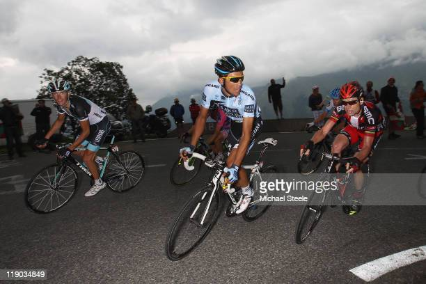 Alberto Contador of Spain and Saxo Bank Sungard shadowed closely by Cadel Evans of Australia and BMC Racing team and Andy Schleck of Luxemburg and...