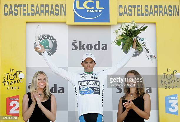 Alberto Contador of Spain and Team Discovery celebrates the white jersey of best young rider on the podium during stage seventeen of the Tour de...