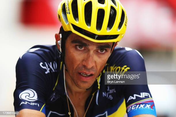 Alberto Contador of Spain and Team Saxo-Tinkoff reacts as he crosses the finish line at the end of stage eighteen of the 2013 Tour de France, a...